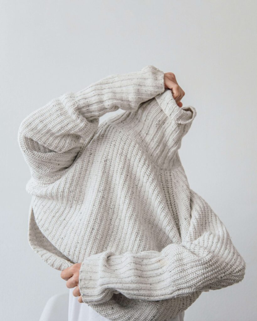 Buying second hand sweaters is another great option