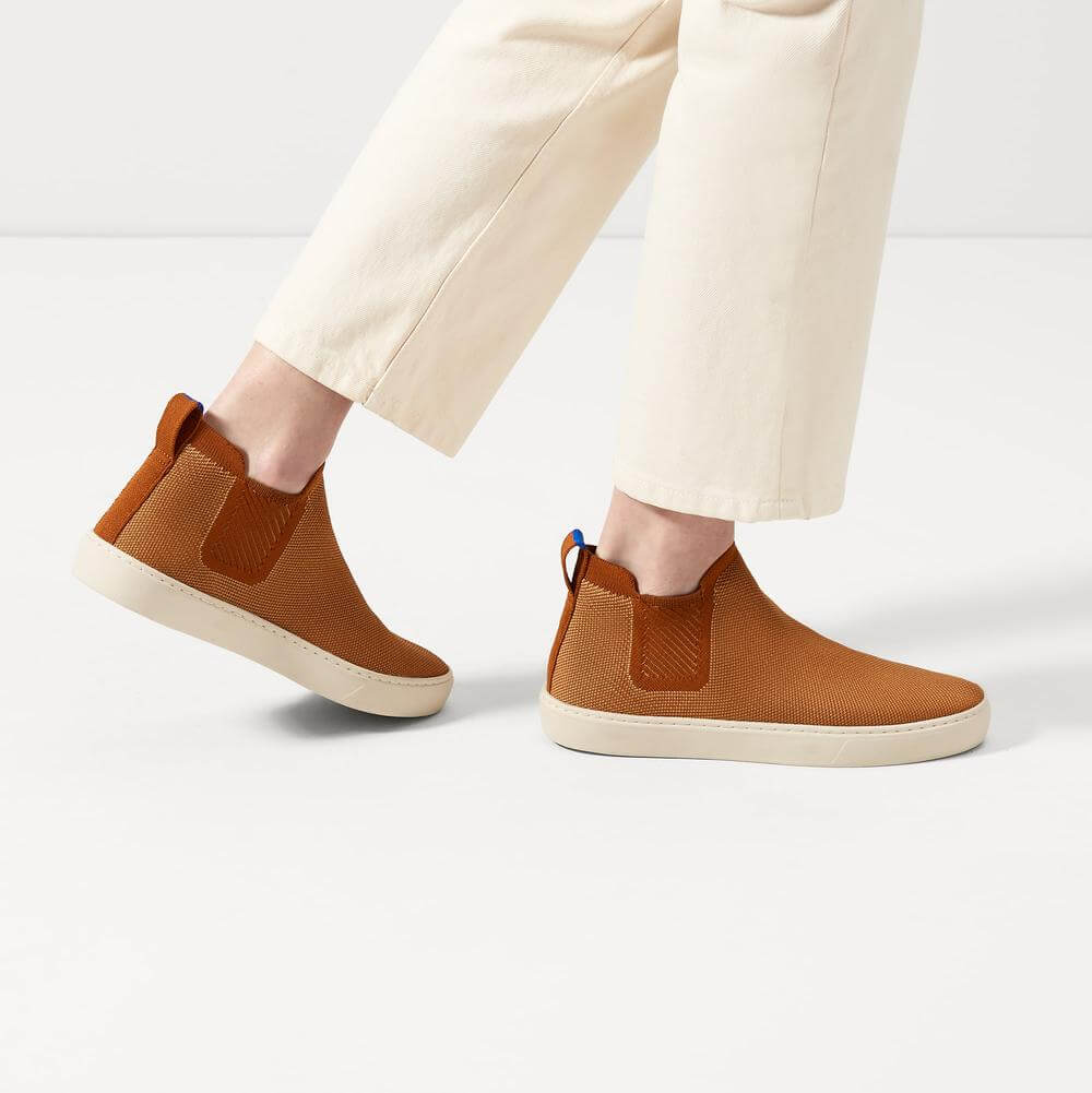 Rothys sustainable chelsea boots in orange knit